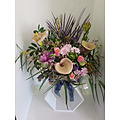 Seasonal flowers in a Basket Arrangement