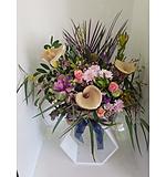 Seasonal flowers in a Basket Arrangement