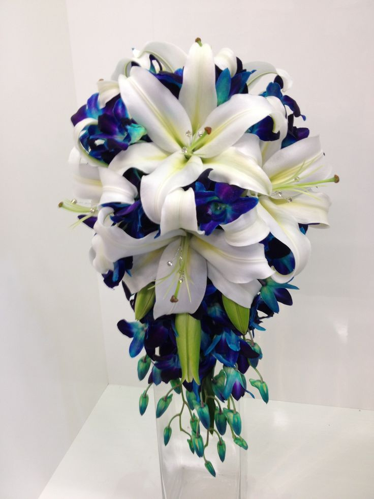 Blue galaxy orchid and white oriental teardrop with diamantes
