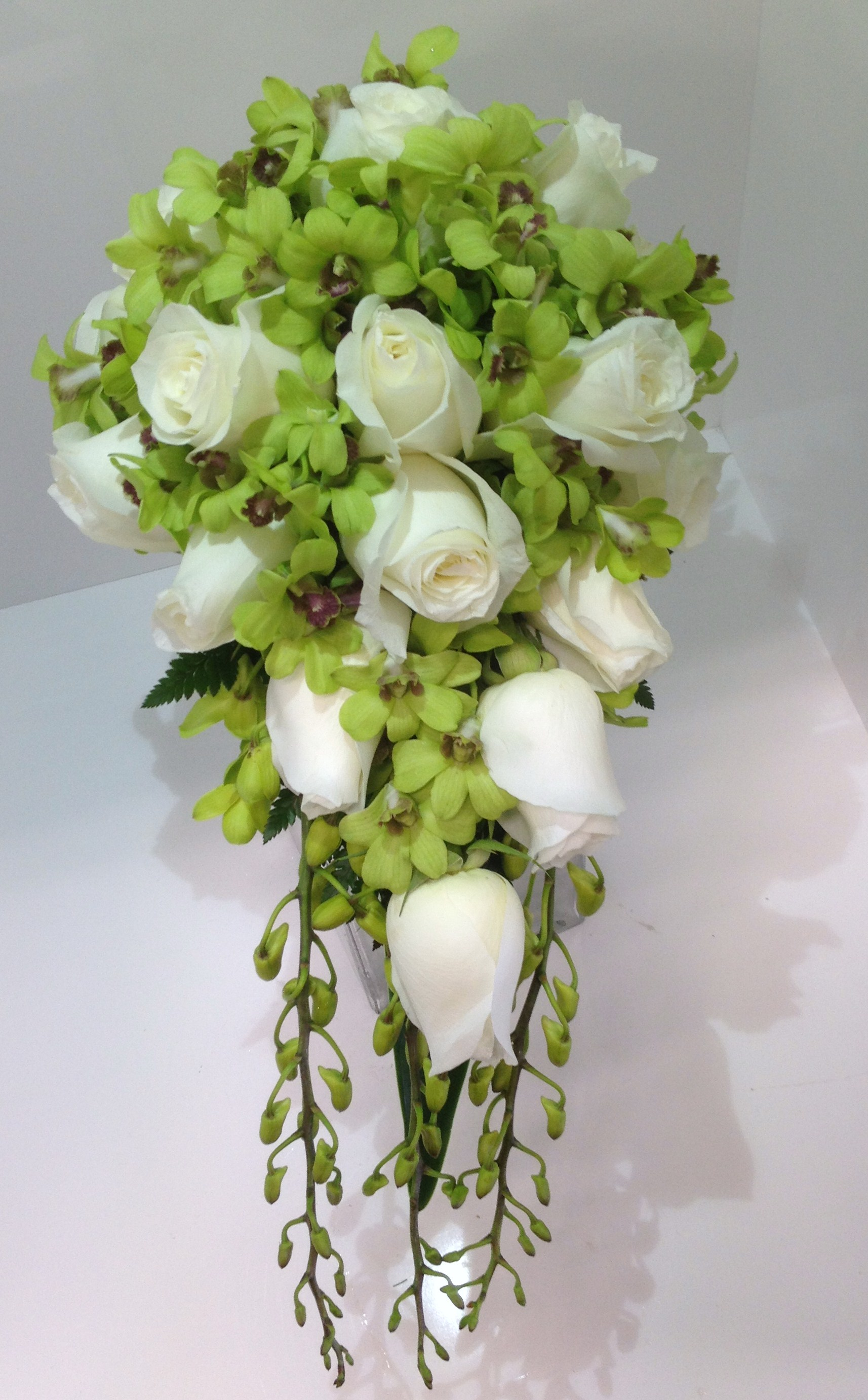 Green orchid white rose tear drop bouquet