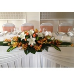 Long and Low with Orange Orchids, Roses and White Oriental Lillies