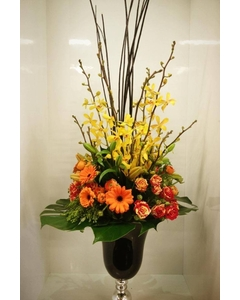spring_black_urn_vase_arrangement_351199497.jpg