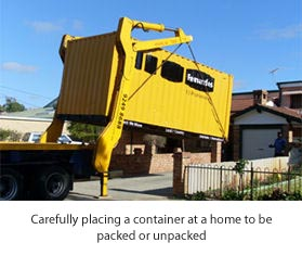 Picture of container being placed on a driveway