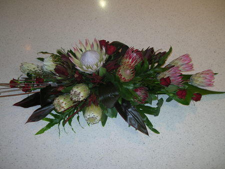 more on Long Low Arrangement - Protea and Roses