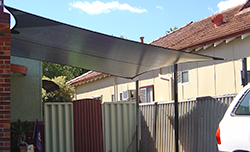 Waterproof shade sail with appropriate slope.