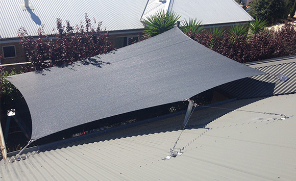 Comshade Platinum shade sail with posts, roof mount and mast.