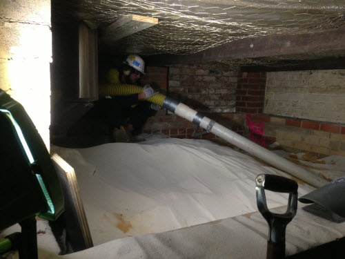 Removing_Insulating_Sand_From_Around_Commercial_Oven